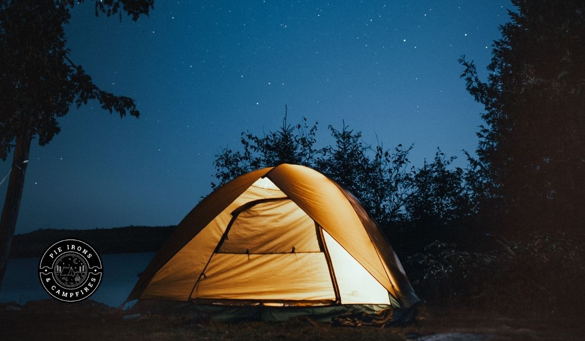 An image of a glowing tent at nights @ PieIronsAndCampfires