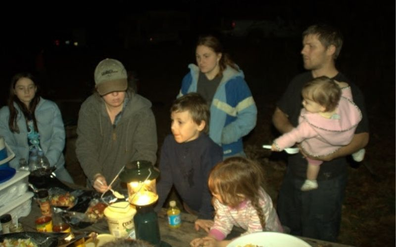 family and toddler on a camp out