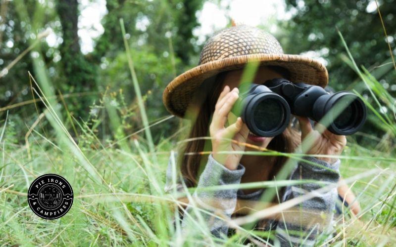 Child Looking through binoculars to find birds.