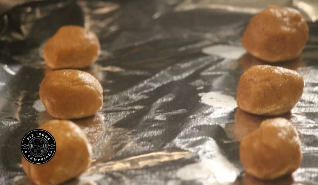 Balls of cookies dough for the recipe Easy Peanut Butter Cookies for Camping @ PieIronsAndCampfires.com